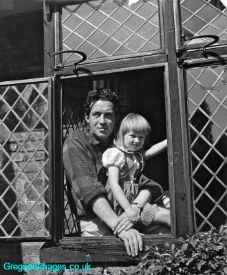 036-Dad-and-Cathy-in-a-window-at-Tudor-Cottage-c-1956