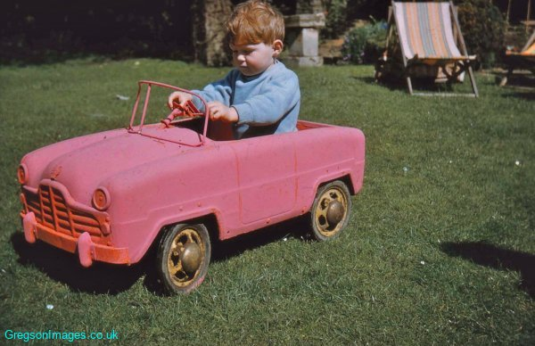040-Johnny-in-his-car-at-Tudor-Cottage-April-1959