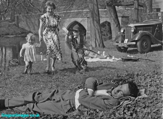 067-Mum-with-Cathy-and-Nicky-pretending-to-wake-up-Dad-Sunday-Express-photo-circa-1954